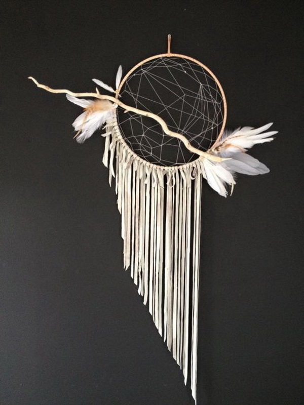 Twig dream catcher. Modern dream catcher. The single twig on the hoop adds more depth and elegance to this modern dream catcher wall hanging piece.
