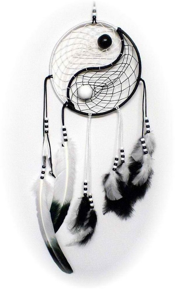 DIY Yin Yang Dream Catcher. A yin-yang inspired dream catcher with white, black and grey feathers, beads and strings.