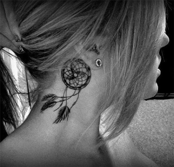 Delicate dreamcatcher tattoo behind the ear.
