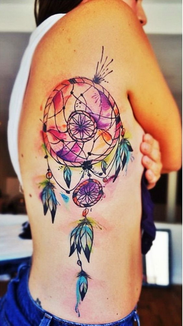 Colorful watercolor dream catcher tattoo on the side back.