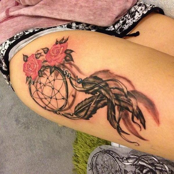 Dreamcatcher tattoo on the thigh.