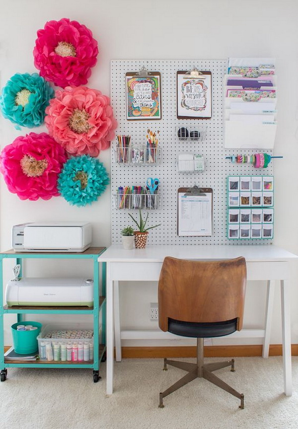 Lovely and beautiful home office design and decoraions. Decorate your work space with quirky accessories—like these oversized paper flowers—to make it feel truly unique.