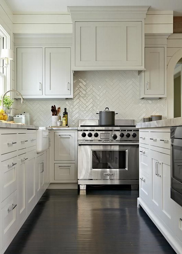 White herringbone tile backsplash.