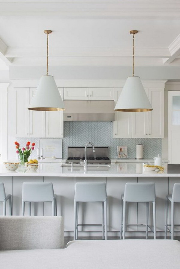 Light blue chevron tile backsplash in a modern costal kitchen.