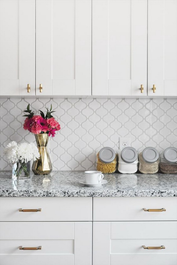 Elegant white arabesque ceramic tile backsplash.