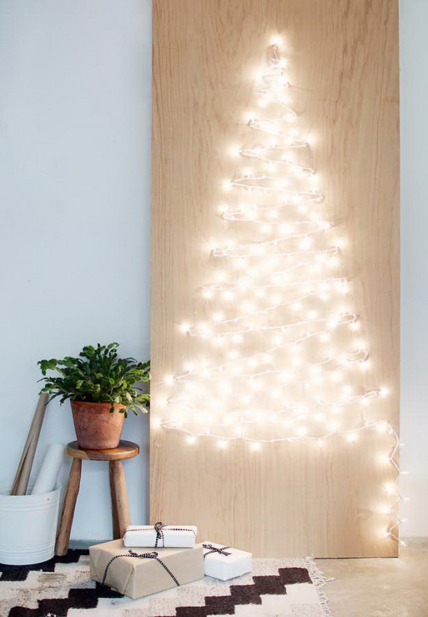 DIY String Light Christmas Tree. Frame out a Christmas tree with string lights! This is such a fantastic idea, and so easy! Look so pretty and a fantastic in a small apartment.