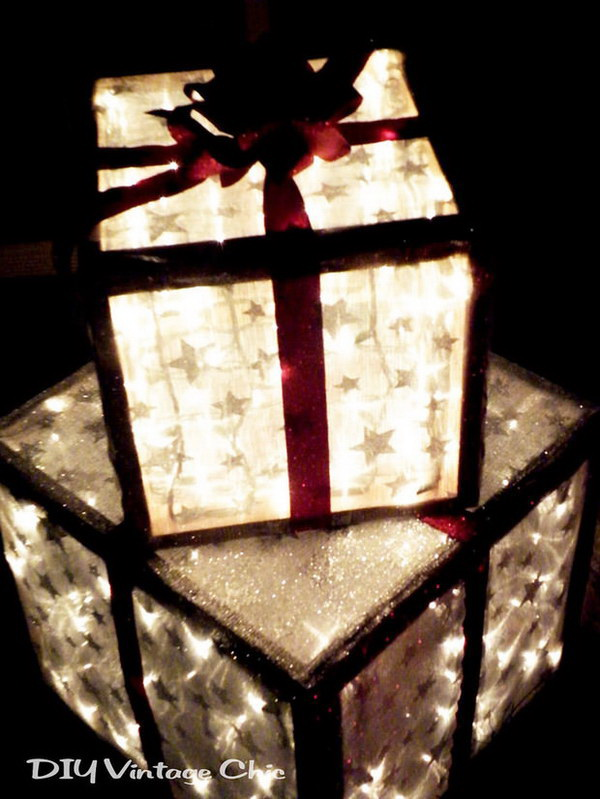 Lighted Christmas Gift Boxes for Outside Decor. These lighted Christmas boxes offer a touch of vintage chic to any outside decor this holiday season.