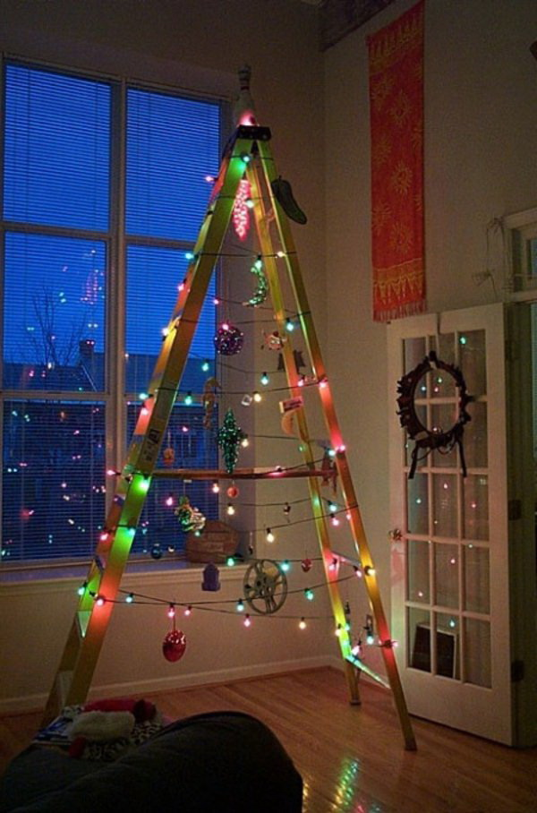 Christmas Ladder Tree with Colorful Fairy Lights. Find a ladder and hang ornaments on it and complement it with colorful Christmas lights! This idea is great both for a corner decoration indoors and outdoors!