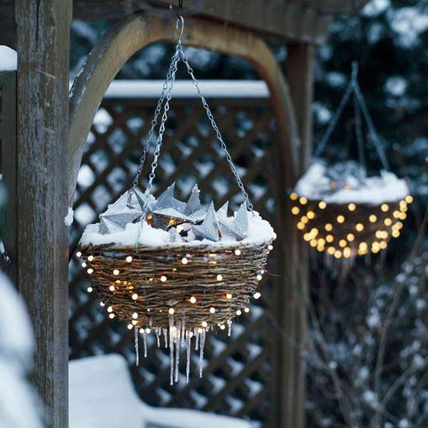 DIY Lighted Hanging Nests. Just fill your hanging baskets with led lights and some garden goodies, then push some through to the outside… A great DIY project for the patio decoration!