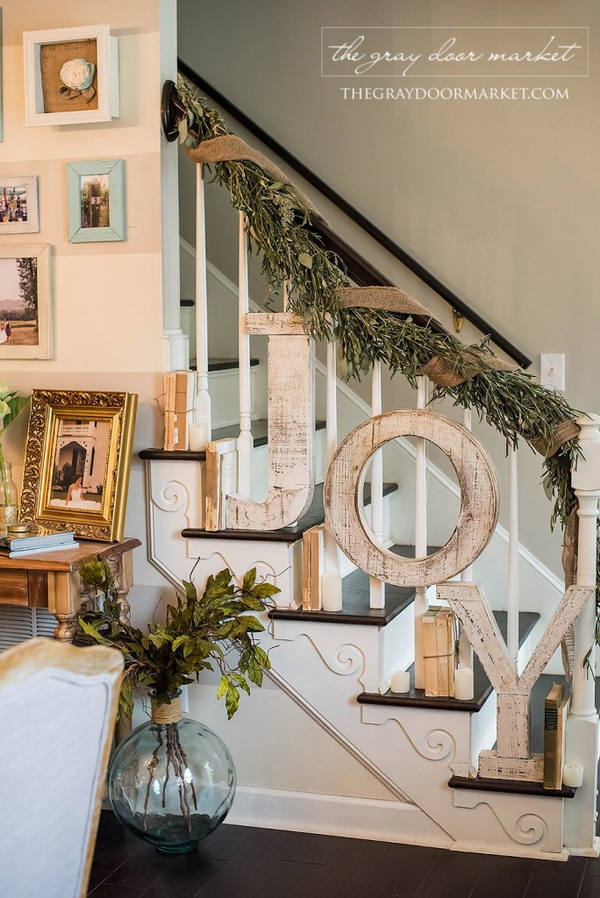 Wooden JOY Sign and Greenary Garland for Banister Decoration. Create your own garland for your banister decoration with greenery, burlap ribbon and a 'Joy' sign and also get your banister in holiday!