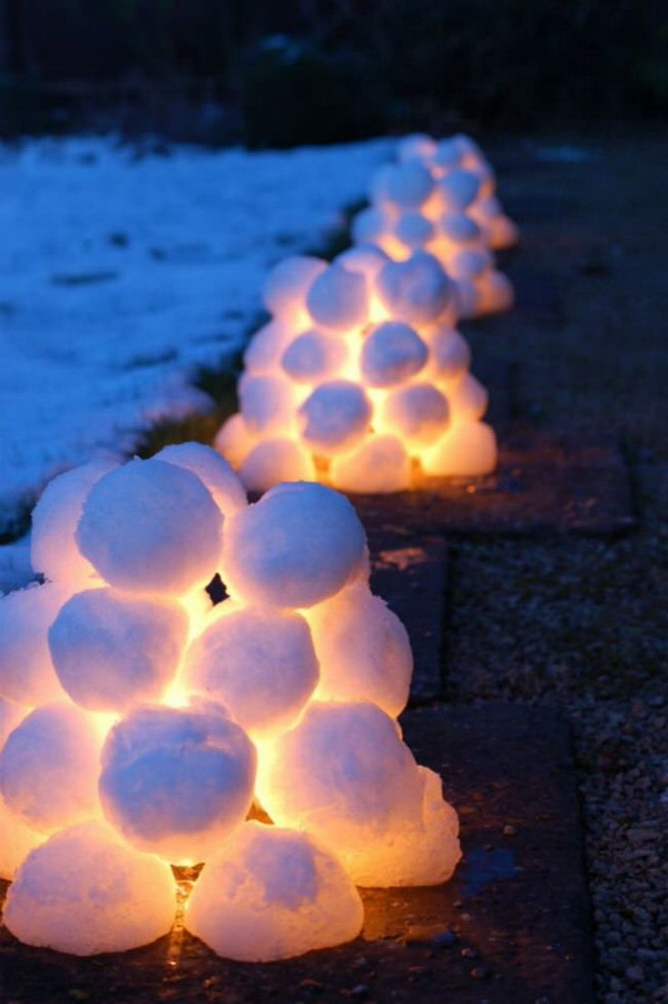 DIY Snowball Lanterns. These snowball lanterns look really stunning and warm by the side of a pathway in your yard! They add warmth and festive feel to this winter holiday!