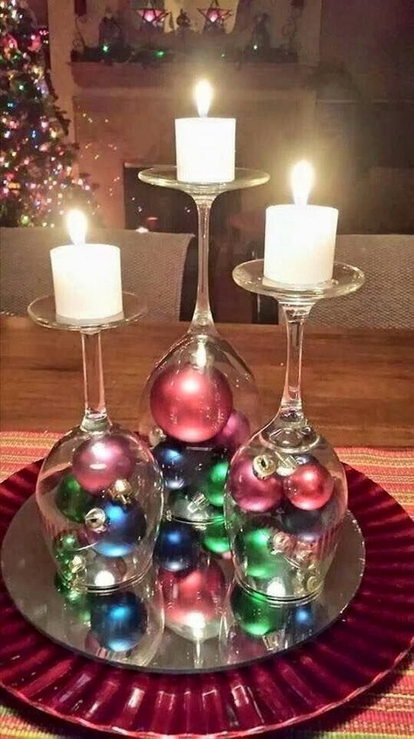 Get clear wine glasses upside down and then decorate it with small Christmas ornament balls in bottom and candles on top! Stunning DIY centerpiece for the holiday!