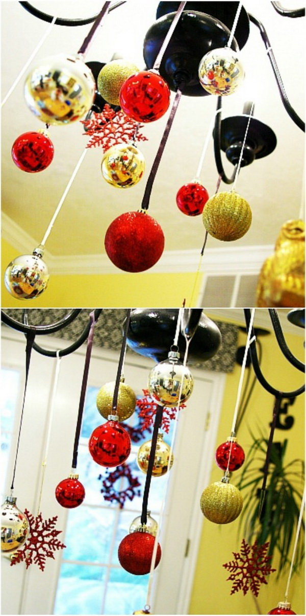 Christmas Ball Ornament Chandelier. Add more festive flair to your Christmas with the addition of a few fun Christmassy ornaments to a light fixture to transform it into a Christmas chandelier for the holiday season! This is a fun way to dress up your dinning room!