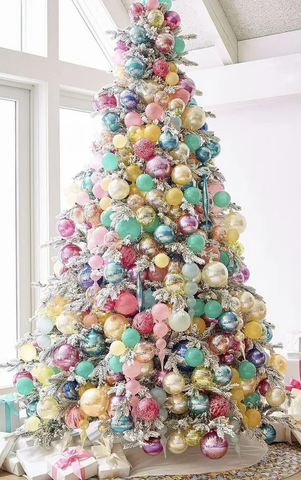 Colorful glass ornaments decorated Christmas tree. Here is a different and unique way to use the holiday ornaments in different colors only. The ends turn out so beautiful and stunning! It will surely add a pop of colors and holiday cheer to your home!