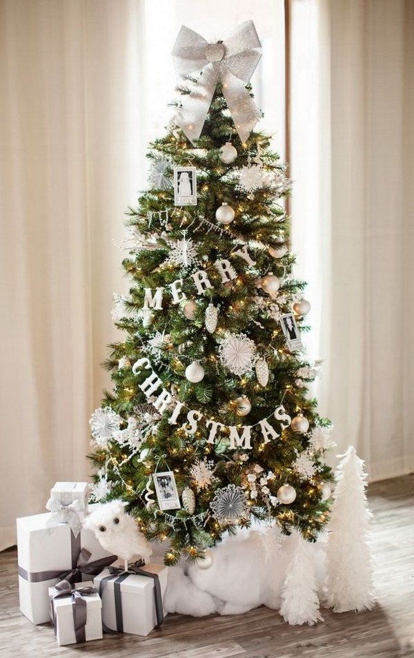 Christmas tree decorated with all white and silver glittery decorations.