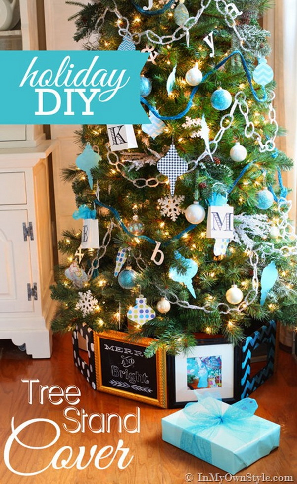 Christmas Tree Stand Cover With Picture Frames. Take out old frames and framed mirrors you don't use anymore and using cardboard hinges, wrap them around the bottom of this tree for an extraordinary take on tree skirts.