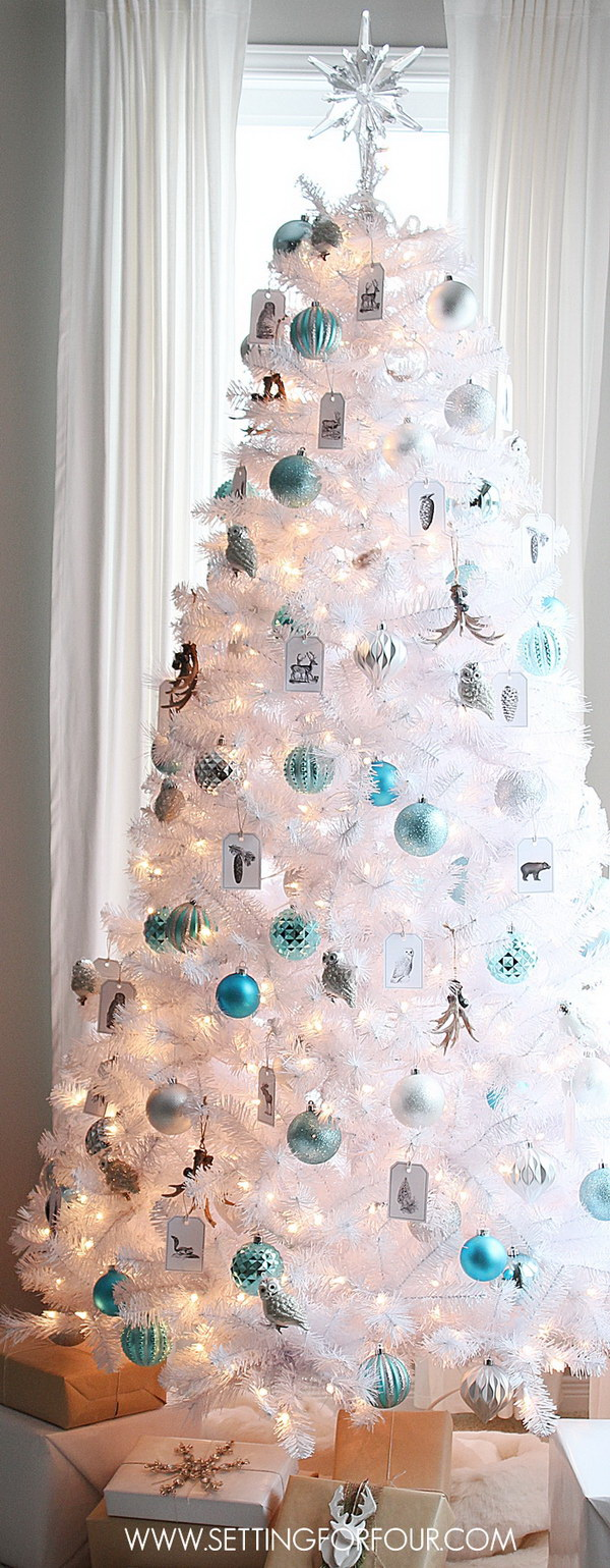 White Christmas Tree with Silver and Blue Ornaments. Love the simple, clear and chic look of this winter Christmas tree. Add blue and silver ornaments to a white themed Christmas tree to get the chic look. The blues take on an inviting and fresh look for the winter holiday!