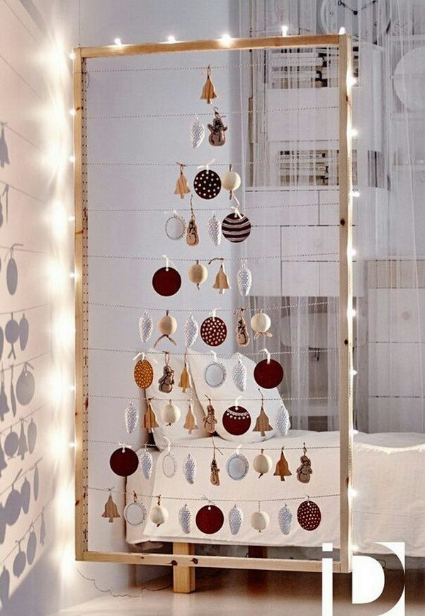 Unique ornaments shaped Christmas tree. String all your treasures in the shape of a Chirstmas tree and then get it framed for a modern and elegant look! What a creative way to display and collect your keepsakes during the holiday season!