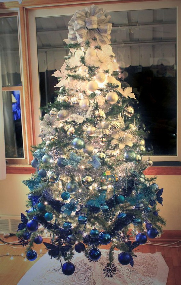 Ombre white to royal blue Christmas tree. Try a new different color scheme instead of the traditional red and green for Christmas tree decoration this year!