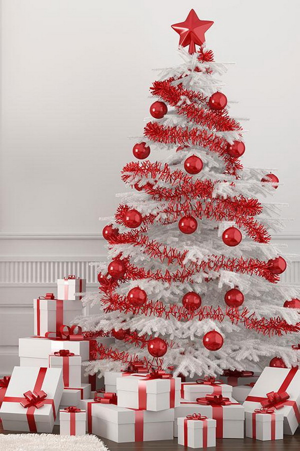 Red and white themed Christmas tree. Decorate the white Christmas tree with all red decorations, ribbons and plastic ornament balls. The white present boxes with red bows stacked beside and the white Christmas tree with red decorations match so well!