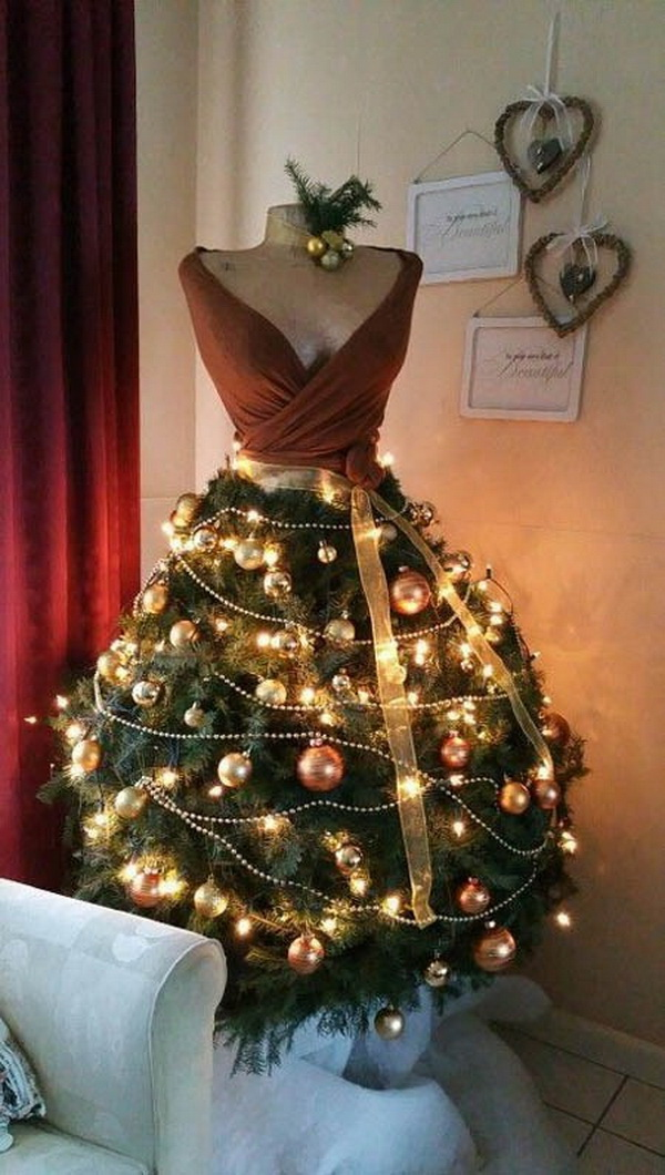 Dress Form Christmas trees. Have a fashion twist and something new for holiday decor with an elegant evergreen dress form Christmas tree in your home this holiday season.