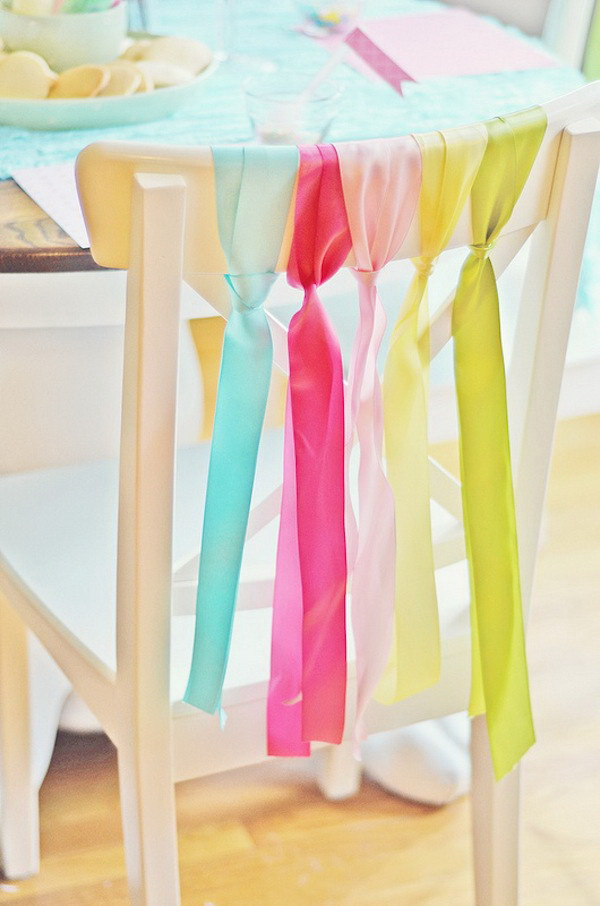 DIY Easter Decoration Ideas: Chairs Decoration with Ribbons for Easter.