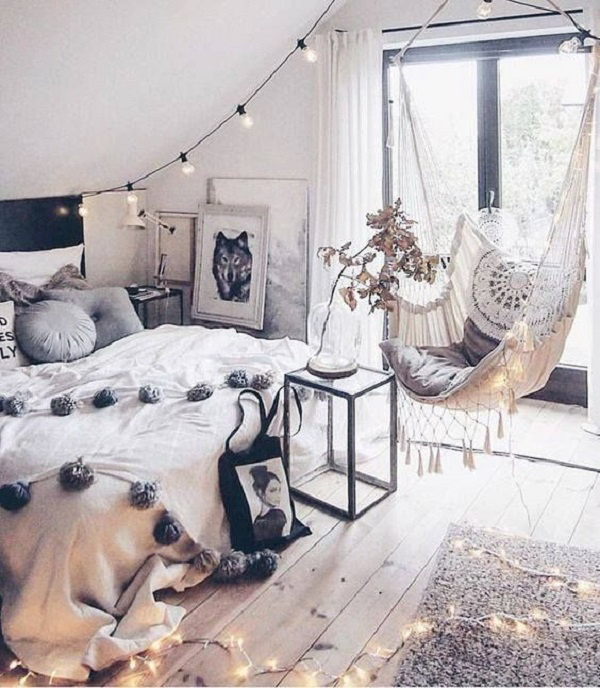 Modern bohemian interior design with hammock.