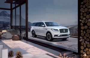 medium resolution of a lincoln black label navigator in the chalet theme is shown parked in the driveway of