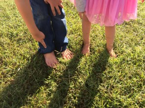 Judah and Anna barefoot on the site of revival in Dunn, NC