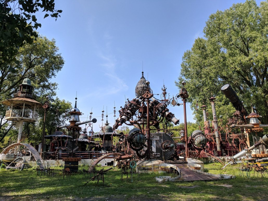 a fantastical park includes a variety of whimsical metal structures