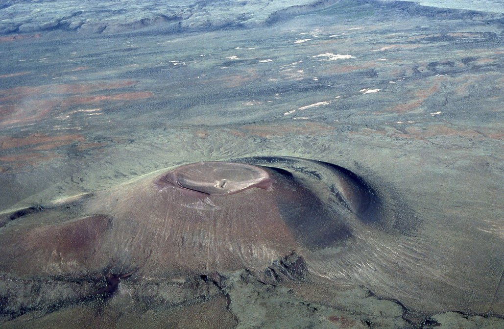 an aerial view of what appears to be a volcano with a sunken top crater