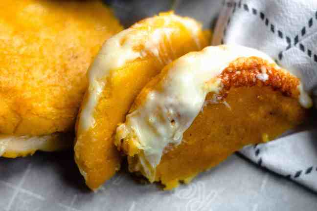 Arepas oozing with cheese