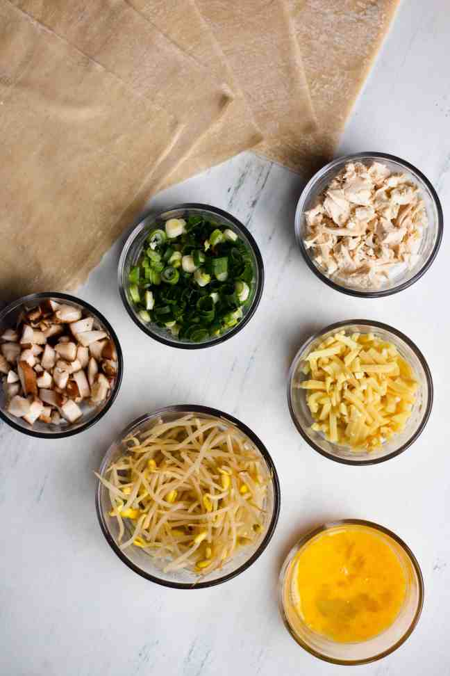 Egg roll ingredients in glass bowls
