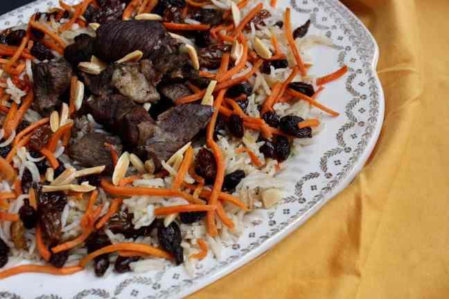 Kabuli Pulao with carrot sticks and raisins