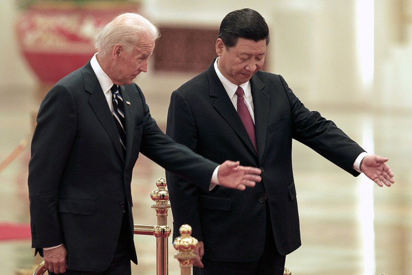 Then Chinese Vice President Xi Jinping invites then U.S. Vice President Joe Biden to view an honor guard during a welcome ceremony inside the Great Hall of the People in Beijing on Aug. 18, 2011. Lintao Zhang/Getty Images