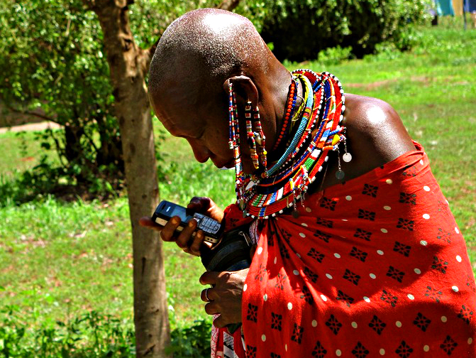 maasai woman with mobile, courtesy University of Denver/flickr (CC BY-NC-SA)