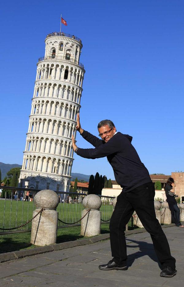 Man holding Tower of Pisa up.