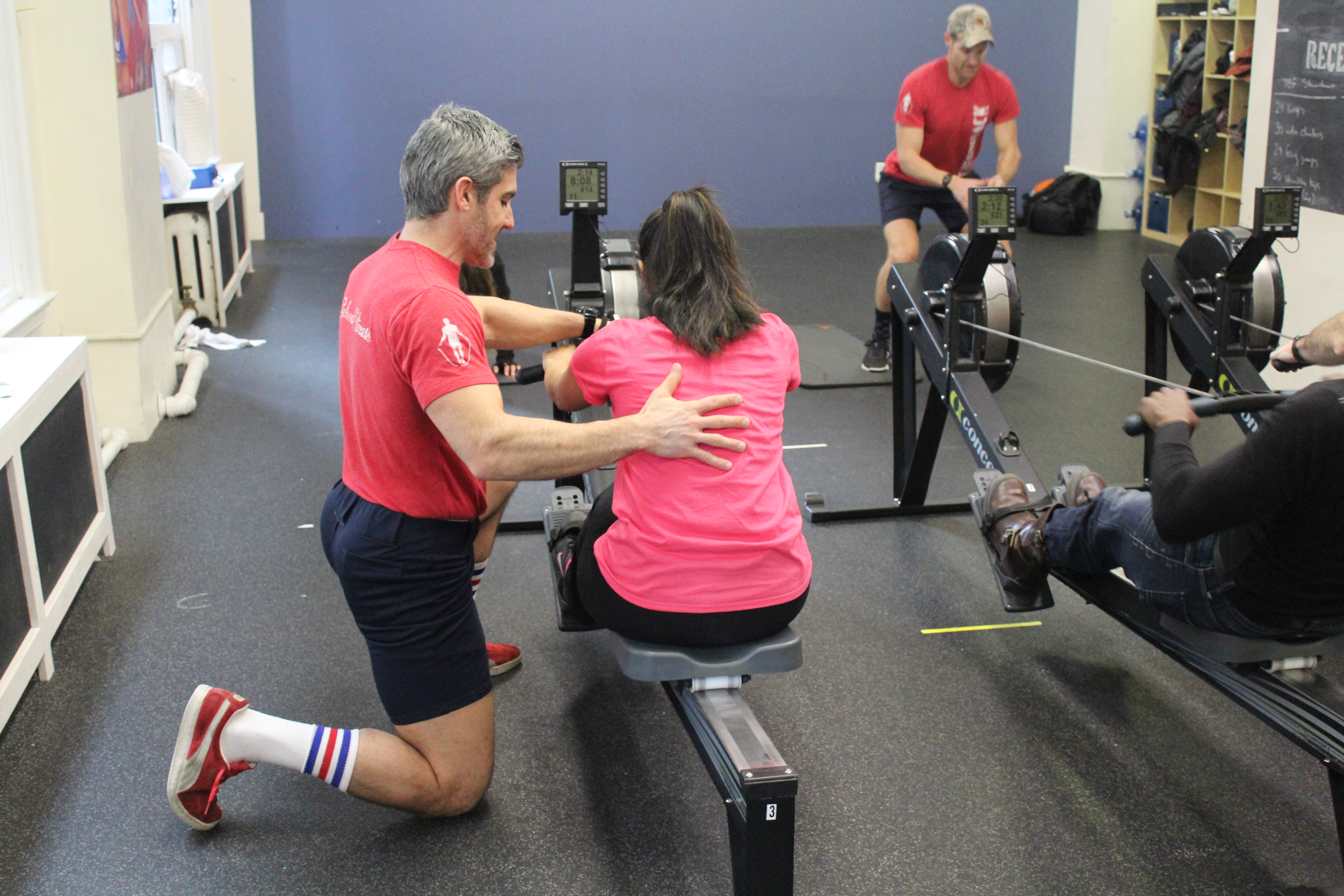 Throwback Fitness owner, Brian, giving a hands-on lesson to a fellow VIP