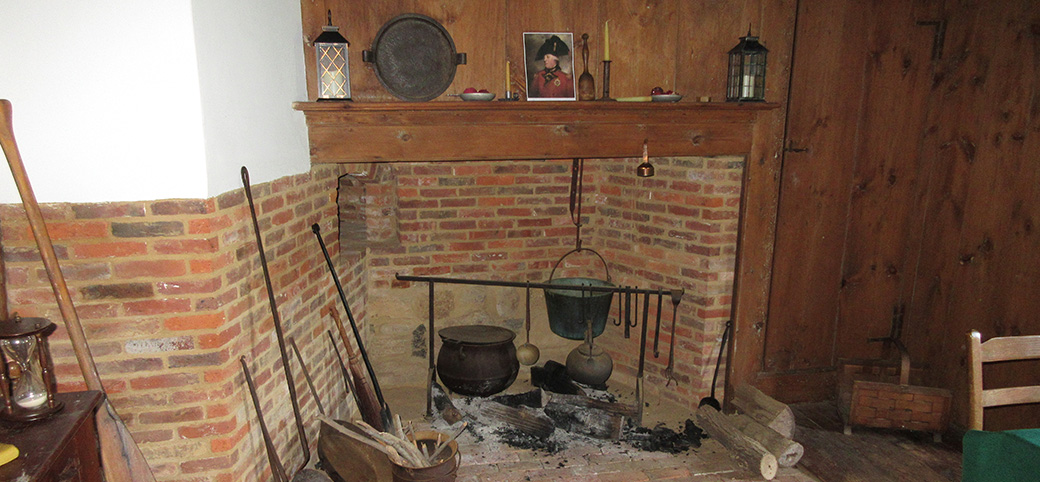 Photo of Fireplace depicting early American cooking methods in the Brewster-House, a saltbox farmhouse circa 1665 located in East Setauket New York