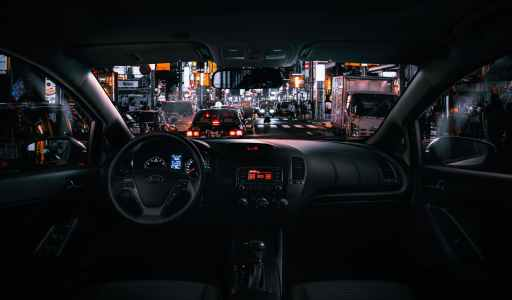 black car steering wheel during night time