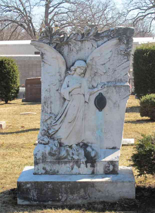 "In Catholic tradition a guardian angel is ""assigned"" to every person when they born to protect them. This angel guards a grave at Resurrection cemetery. Photo by Gioconda Coello"