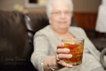 grandmother holding a glass of drink