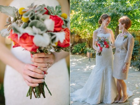 mother and bride holing a bouquet of flowers looking at each other