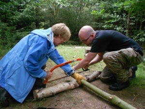 Demonstrate use of bow saw in forest school