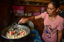 Changing diets in Kapuas Hulu Ibu Rosalina cooking fish with Keluwih.
