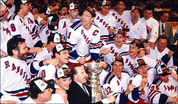 Joe Kocur to Mike Keenan's left celebrates the 1994 Cup (Getty)