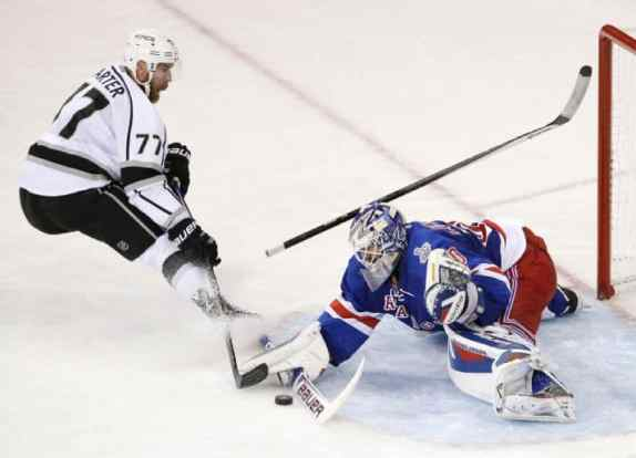 Lundqvist stood on his head all night, here robbing Jeff Carter. (AP Photo/Frank Franklin II)