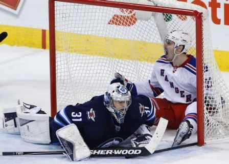 Chris Kreider celebrates GWG vs. Jets (AP Photo/The Canadian Press, John Woods)