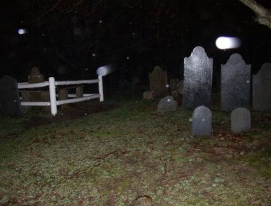 An orb caught at a cemetery- a reflection of the flash or a ghost?