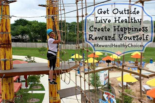 Midlife mom climbing ropes course for her healthy lifestyle.